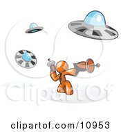 Orange Man Fighting Off UFOs With Weapons Clipart Illustration