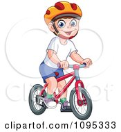 Happy Boy Wearing A Helmet And Riding A Bicycle