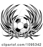 Clipart Soccer Ball With Wings Royalty Free Vector Illustration by Chromaco