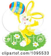Clipart Happy Yellow Easter Bunny Holding Up A Colorful Egg Royalty Free Vector Illustration