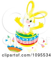 Clipart Yellow Easter Bunny Bursting Through A Colorful Egg Royalty Free Vector Illustration