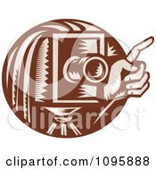 Clipart Retro Brown Box Camera And Photographers Hand Holding A Finger Up Royalty Free Vector Illustration by patrimonio