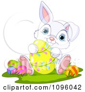 Clipart Cute Bunny Sitting And Holding A Yellow Easter Egg Royalty Free Vector Illustration
