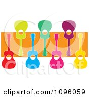 Colorful Ukuleles Over An Orange Stripe