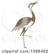 Clipart Retro Woodcut Styled Brown Crane Or Heron Bird Royalty Free Vector Illustration by patrimonio