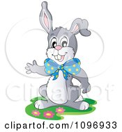 Clipart Happy Easter Rabbit Wearing A Bow And Presenting Royalty Free Vector Illustration