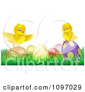 Cute Yellow Easter Chicks On Top Of Decorated Eggs In Grass