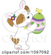 Clipart Cute Puppy Wearing Bunny Ears And Holding An Easter Egg With A Chick Royalty Free Vector Illustration by Maria Bell
