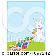 Clipart Cute White Easter Bunny Carrying A Basket And Leaving A Trail Of Eggs With Copyspace On Blue Royalty Free Vector Illustration