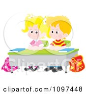 Cute School Boy And Girl Seated Patiently At Their Desk