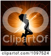 Clipart Sexy Silhouetted Woman Dancing Over An Orange Burst Royalty Free Vector Illustration