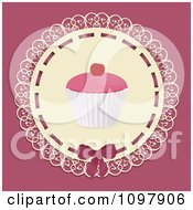 Clipart Frosted Cupcake On Lace Over A Pink Background Royalty Free Vector Illustration