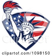 Clipart Statue Of Liberty Holding Up A Torch In An American Flag Shield Royalty Free Vector Illustration