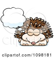 Clipart Dreaming Hedgehog Royalty Free Vector Illustration