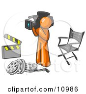 Orange Man Filming A Movie Scene With A Video Camera In A Studio Clipart Illustration