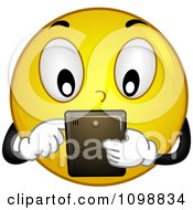 Clipart Yellow Techie Smiley Emoticon Using A Tablet Royalty Free Vector Illustration