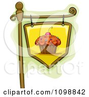 Clipart Hanging Cupcake Sign Royalty Free Vector Illustration
