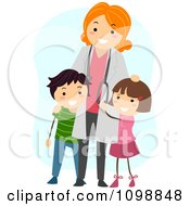 Friendly Female Pediatric Doctor Standing With Two Kids