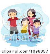 Happy Family Playing In A Rain Puddle