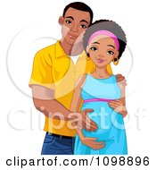 Happy Pregnant Black Woman And Her Husband Posing And Holding Her Baby Belly