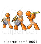 Three Orange Men Playing Flutes And Drums At A Music Concert