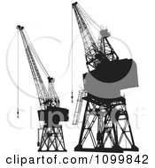 Black And White Silhouetted Construction Cranes And Platforms