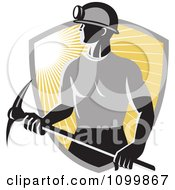 Clipart Retro Coal Miner Holding Pick Ax Over A Ray Shield Royalty Free Vector Illustration