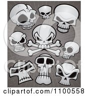 Clipart Human Skulls And Cross Bones Over Grungy Gray Royalty Free Vector Illustration