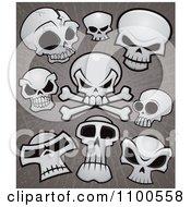 Clipart Human Skulls And Cross Bones Over Grungy Gray Royalty Free Vector Illustration