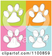 Clipart White Animal Paw Prints On Green Orange Pink And Blue Royalty Free Vector Illustration by michaeltravers