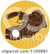 Clipart Retro Brown Video Camera In A Circle Of Rays Royalty Free Vector Illustration