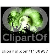 Clipart Silhouetted Soccer Fan Crowd Cheering With A Green Glowing Ball On Black Royalty Free Vector Illustration