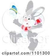 Clipart Happy Gray Rabbit Running With A Winter Hat And Scarf Royalty Free Vector Illustration by Alex Bannykh