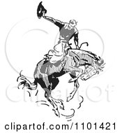 Clipart Retro Black And White Rodeo Cowboy On A Bucking Horse 2 Royalty Free Vector Illustration