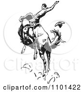 Clipart Retro Black And White Rodeo Cowboy On A Bucking Horse 3 Royalty Free Vector Illustration by BestVector