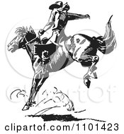 Clipart Retro Black And White Rodeo Cowboy On A Bucking Horse 4 Royalty Free Vector Illustration