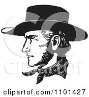 Clipart Retro Black And White Cowboy Face In Profile Royalty Free Vector Illustration