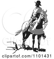 Clipart Retro Black And White Wrangler Cowboy Looking Back On A Horse Royalty Free Vector Illustration
