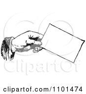 Clipart Retro Black And White Hand Holding A Business Card Royalty Free Vector Illustration