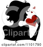 Clipart Silhouetted Woman Holding A Red Heart Royalty Free Vector Illustration