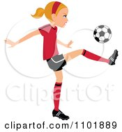 Blond Soccer Girl Player Kicking A Ball