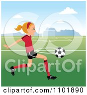 Blond Soccer Girl Player Kicking A Ball On A Field