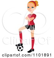 Blond Female Soccer Player Resting Her Foot On A Ball