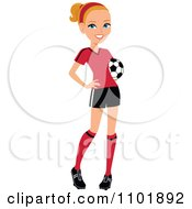 Blond Female Soccer Player Posing With A Ball