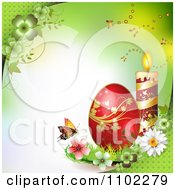 Red Easter Egg With A Candle And Butterfly On Green