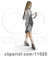 Young Businesswoman Looking Down At Paperwork While Walking
