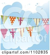 Patterned And UK Bunting Flags Against A Cloudy Sky