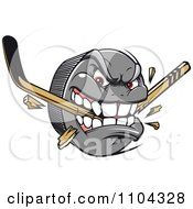 Clipart Aggressive Hockey Puck Biting And Snapping A Stick Royalty Free Vector Illustration