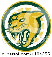 Clipart Cougar Hissing Over A Green Yellow And White Circle Royalty Free Vector Illustration by patrimonio