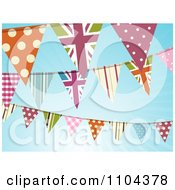 British And Patterned Bunting Flags Against A Blue Sky With Sunshine
